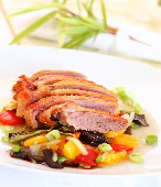 a_duck_breast_roasted_over_salad