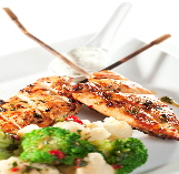 a_grilled_chicken_on_plate
